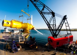 Ocean Energy Europe - an Alstom 1MW aqua-turbine being lifted into water. The worker (bottom right) gives an indication of scale.